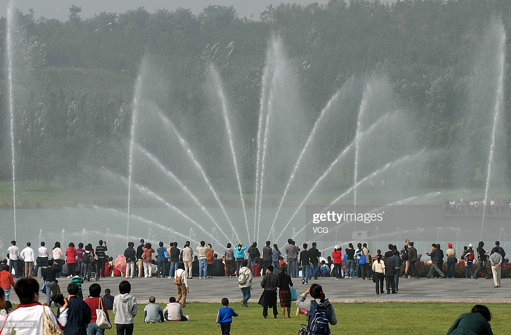 Visitors watch the music fountain on the Olympic Green on September 29, 2008 in Beijing, China. Tourists from across China and abroad came to the the Olympic Green in Beijing to visit the competition venues on the first day of the week-long National Day holiday.