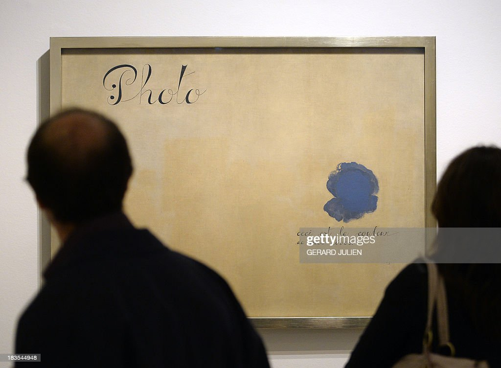 Visitors watch the painting 'Este es el color de mis sueños' by Joan Miro during the exhibition entitled 'Surrealism and the Dream' at the Thyssen-Bornemisza museum in Madrid, on October 7, 2013. AFP PHOTO/ GERARD JULIEN