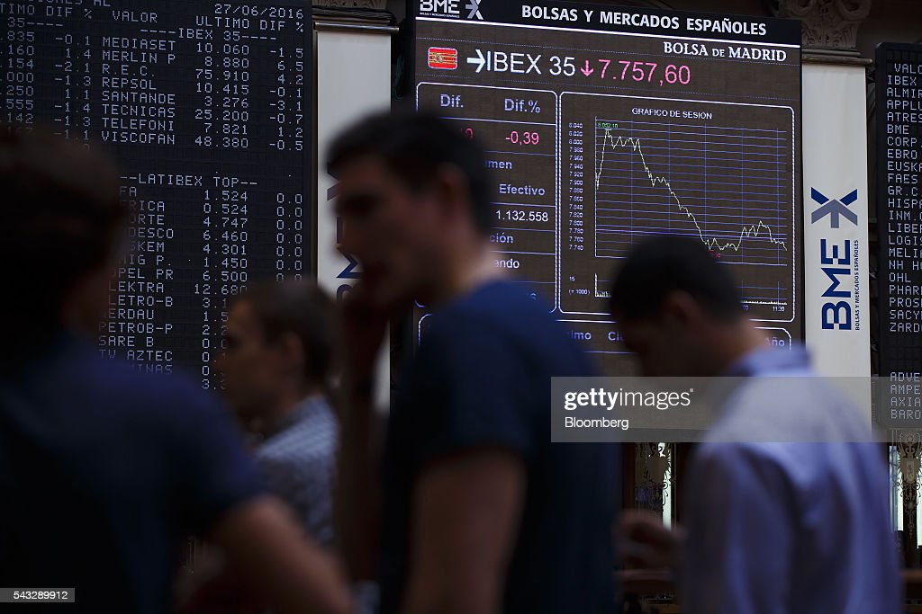 Visitors watch the performance of the Ibex 35 stock index on electronic screens at the Madrid stock exchange, also known as Bolsas y Mercados Espanoles, in Madrid, Spain, on Monday, June 27, 2016. Spanish government bonds jumped, pushing the yield down by the most in eight months, after Acting Prime Minister Mariano Rajoy defied opinion polls to consolidate his position in the country's general election after Brexit rocked the world's financial markets last week. Photographer: Angel Navarrete/Bloomberg via Getty Images