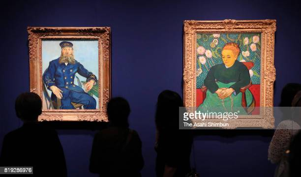 Visitors watch the 'Portrait of the Postman Joseph Roulin' and La Berceuse by Vincent van Gogh during the 'Great Collectors Masterpieces From The...