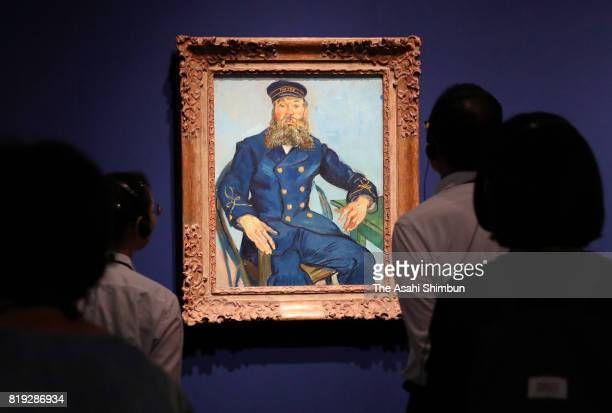 Visitors watch the 'Portrait of the Postman Joseph Roulin' by Vincent van Gogh during the 'Great Collectors Masterpieces From The Museum Of Fine Arts...
