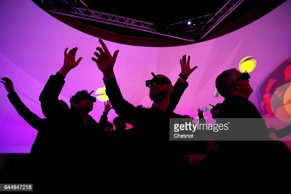 Visitors wear 3D glasses to experience 3D virtual reality during the show 'Virtuality Paris 2017' on February 24 2017 in Paris France The first...