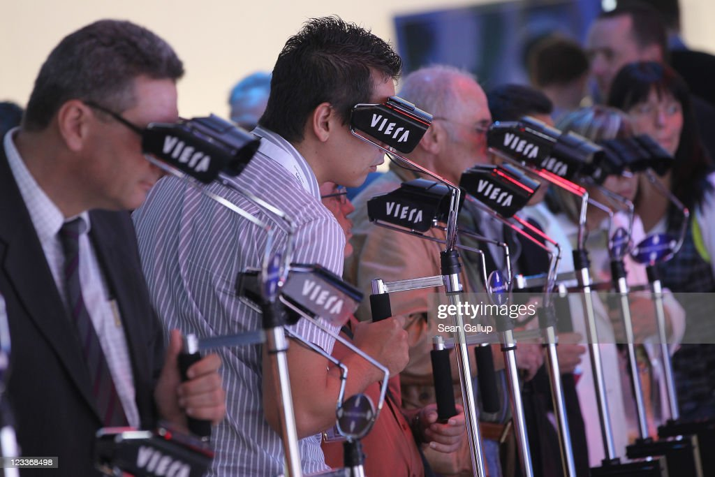 Visitors wear 3D glasses while watching 3D camcorder presentations at the Panasonic stand at the IFA 2011 consumer electonics and appliances trade fair on the first day of the fair's official opening on September 2, 2011 in Berlin, Germany. The IFA 2011 will be open to the public from September 2-7.