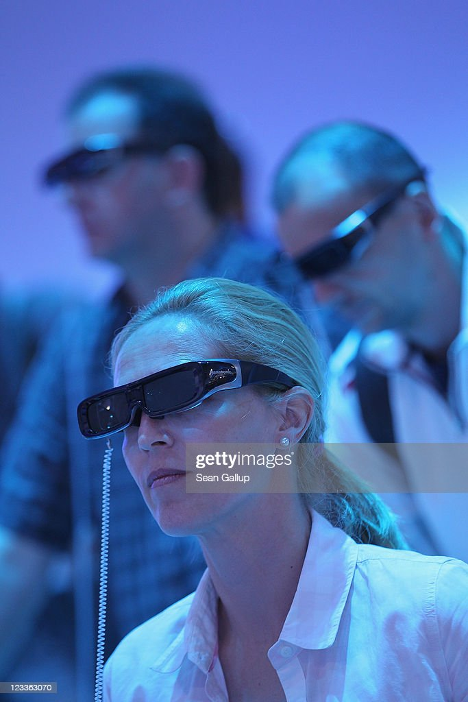 Visitors wear 3D glasses while watching a presentation of 3D televisions at the Panasonic stand at the IFA 2011 consumer electonics and appliances trade fair on the first day of the fair's official opening on September 2, 2011 in Berlin, Germany. The IFA 2011 will be open to the public from September 2-7.