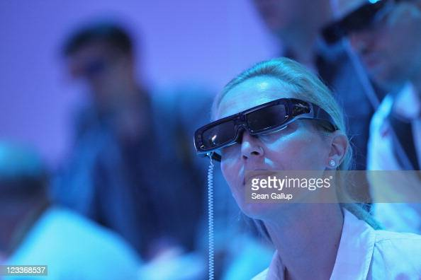 Visitors wear 3D glasses while watching a presentation of 3D televisions at the Panasonic stand at the IFA 2011 consumer electonics and appliances...