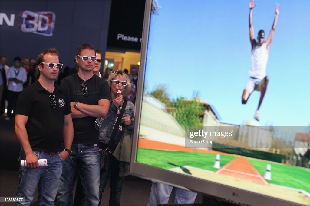 Visitors wear 3D glasses while watching a presentation of 3D televisions at the LG stand at the IFA 2011 consumer technology trade fair on the first day of the fair's official opening on September 2, 2011 in Berlin, Germany. The IFA 2011 will be open to the public from September 2-7.