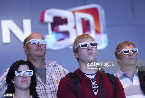 Visitors wear 3D glasses while watching a presentation of 3D Smart TV at the LG stand at the IFA 2011 consumer technology trade fair on the first day...