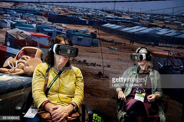 TOPSHOT Visitors wear virtual reality glasses at a booth of the 4th Women Deliver Conference in Copenhagen on May 17 2016 The conference is the...