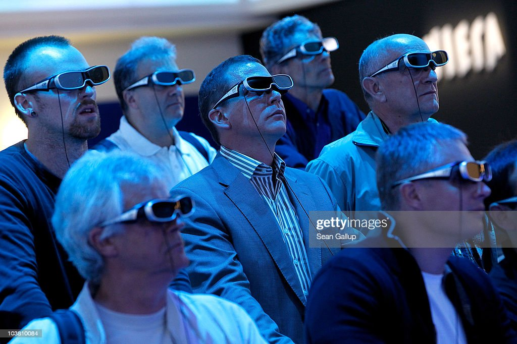 Visitors wearing 3D glasses watch a presentation on 3D televisions at the Panasonic stand at the 2010 IFA technology and consumer electronics trade fair at Messe Berlin on September 3, 2010 in Berlin, Germany. The 2010 IFA will be open to the public from September 3-8.