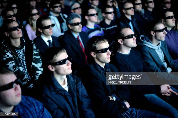 Visitors wearing 3D glasses watch a videoclip at the stand of US visual computer technologies company Nvidia at the world's biggest hightech fair the...