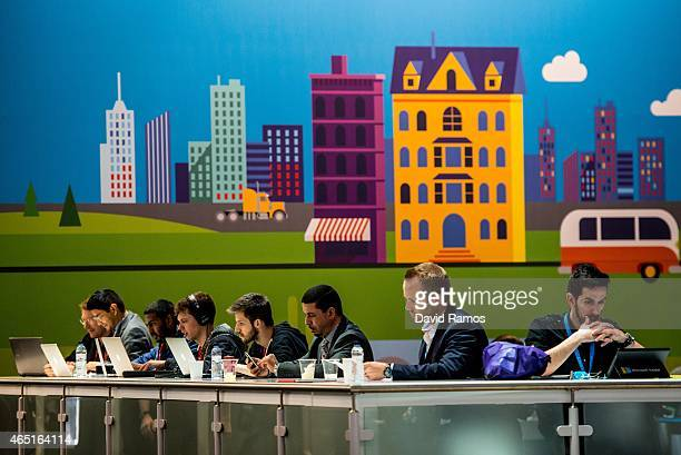 Visitors work on their laptops during the second day of the Mobile World Congress 2015 at the Fira Gran Via complex on March 3 2015 in Barcelona...