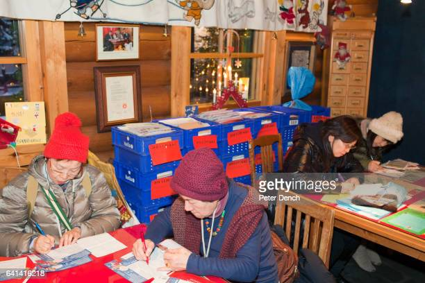 Visitors write their Christmas letters at the Arctic Circle post office The 'real' Santa Claus is available to visit every day of the year at the...