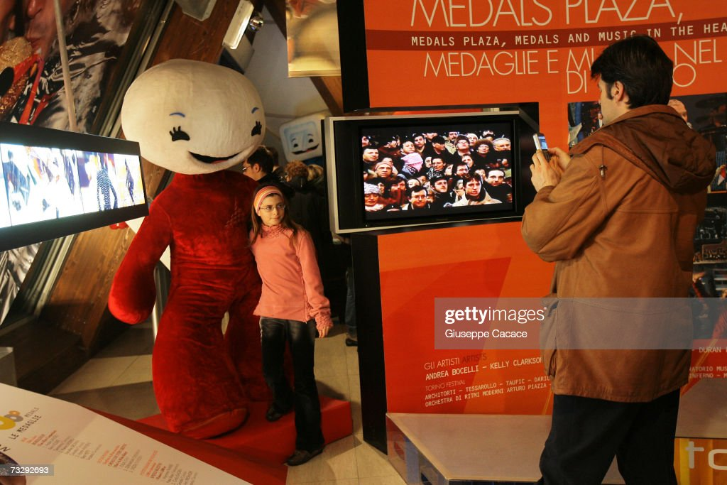 A visitortake a photo of his daughter with Gliz during the opening ceremony for the Olympic Museum at Atrium on February 10, 2007 in Turin, Italy.