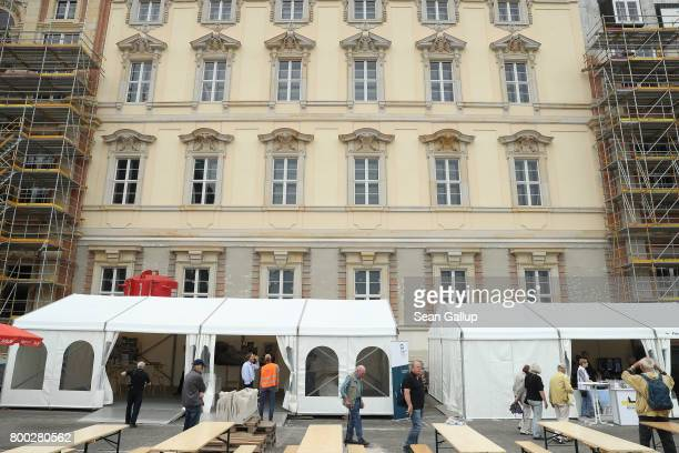 Visitos walk among tents outside a finished facade during open house day at the construction site of the Berlin City Palace which will house the...