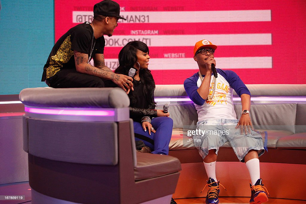 <a gi-track='captionPersonalityLinkClicked' href=/galleries/search?phrase=T.I.&family=editorial&specificpeople=221599 ng-click='$event.stopPropagation()'>T.I.</a> visits BET's 106 & Park with Host's (L) <a gi-track='captionPersonalityLinkClicked' href=/galleries/search?phrase=Bow+Wow+-+Rapper&family=editorial&specificpeople=211211 ng-click='$event.stopPropagation()'>Bow Wow</a> and (Center) Paigion at BET Studios on May 1, 2013 in New York City.