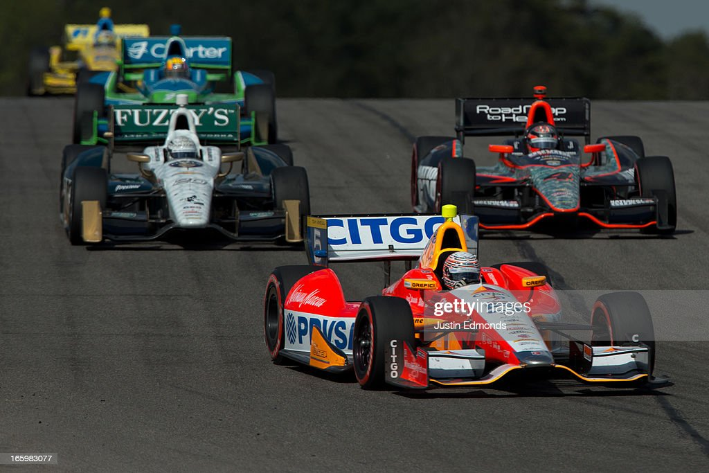 E.J. Viso of Venezuela, driver of the #5 Team Venezuela/Andretti Autosport/HVM Dragon Racing Chevrolet leads a pack of cars during the Honda Indy Grand Prix of Alabama at Barber Motorsports Park on April 7, 2013 in Birmingham, Alabama.