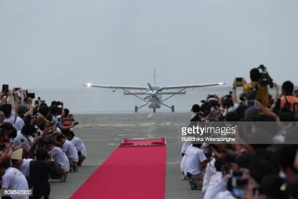 Vissel Kobe new player Lukas Podolski boarded airplane arrives as fans line up for cheering sign during the welcome ceremony at the Kobe Airport on...