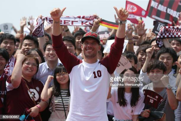 Vissel Kobe new player Lukas Podolski poses a picture with Football fans during the welcome ceremony at the Kobe Airport on July 6 2017 in Kobe Hyogo...