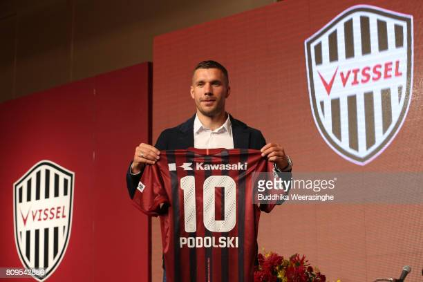 Vissel Kobe new player Lukas Podolski poses with his new jersey during a press conference on July 6 2017 in Kobe Hyogo Japan