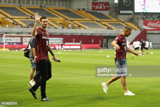 Vissel Kobe new players Lukas Podolski and Mike Havenaar applaud supporters prior to the JLeague J1 match between Vissel Kobe and Vegalta Sendai at...