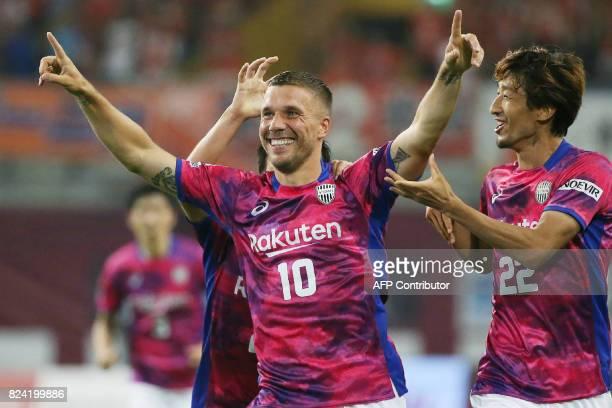 Vissel Kobe's Lukas Podolski of Germany celebrates his first goal with his teammates during his JLeague football match against Omiya Ardija in Kobe...