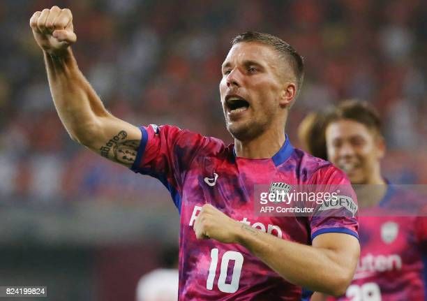 Vissel Kobe's Lukas Podolski of Germany celebrates scoring his first goal during his JLeague football match against Omiya Ardija in Kobe on July 29...