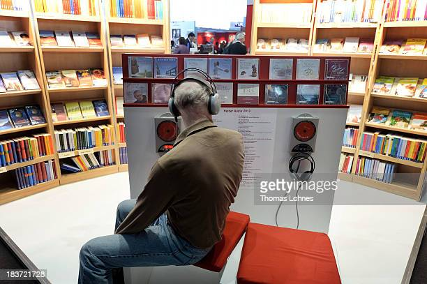 A vistior listens to audio books at the 2013 Frankfurt Book Fair on October 9 2013 in Frankfurt Germany This year's fair will be open to the public...
