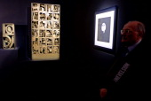 A vistor looks at sculptures by US artist Louise Nevelson during the press preview of the 'Louise Nevelson' exhibition on April 15 2013 at the...