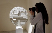 A vistor takes pictures of sculptures by US artist Louise Nevelson during the press preview of the 'Louise Nevelson' exhibition on April 15 2013 at...