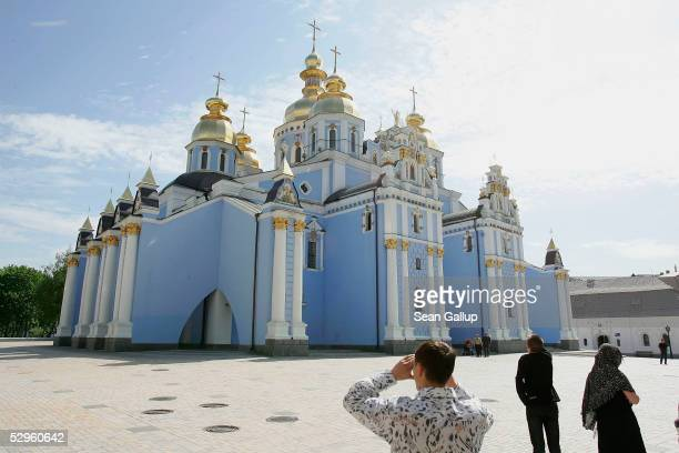 Vistors arrive at St Michael's monastery May 18 2005 in central Kiev Ukraine St Michael's was destroyed in the 1930s under the Stalin regime and...