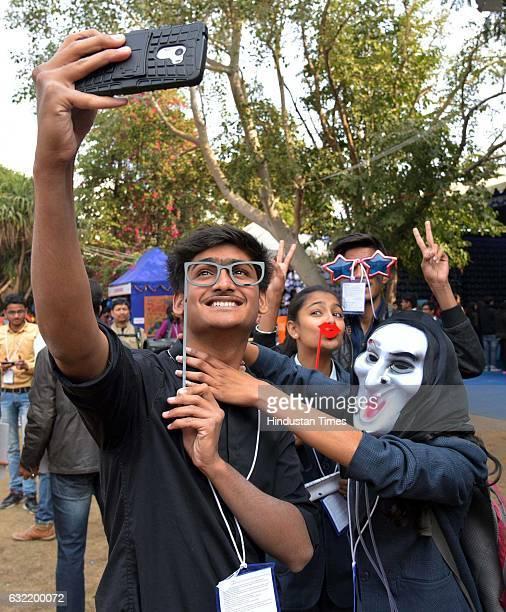 Vistors during JLF taking selfie at Diggi Palace on January 20 2017 in Jaipur India