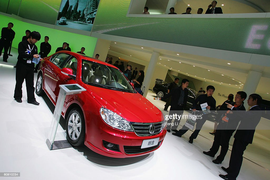 Vistors look at the world premiere display of the Volkswagen Lavida during a special media opening of the Auto China 2008 show at the new China International Exhibition Center on April 21, 2008 in Beijing, China. The annual auto show is held from April 20-28 with 890 vehicles including 55 concept cars on show.