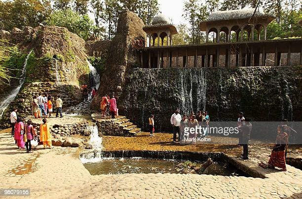 Vistors takes pictures of each other at the Rock Garden on March 26 2010 in Chandigarh India The 12acre Rock Garden which began as secret project of...