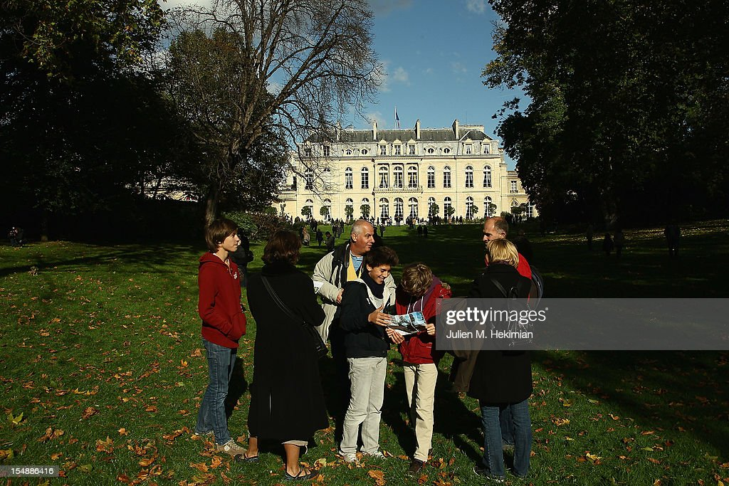 Vistors talk in the 18th-century Elysee Palace gardens on October 28, 2012 in Paris, France. Hundreds of Parisians and tourists took the opportunity to visit the The gardens of France's Presidential palace that are to be opened to the public every last Sunday of the month, a policy that was inaugurated by President Francois Hollande .