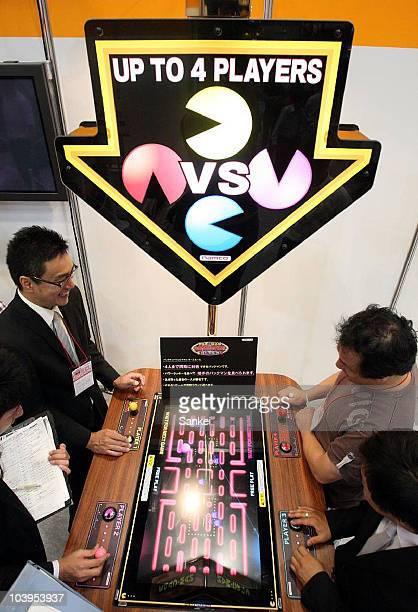 Vistors trys Bandai Namco holdings' 'Pacman Battle Royal' during the 48th Amusement Machine Show at Makuhari Messe on September 9 2010 in Chiba Japan...