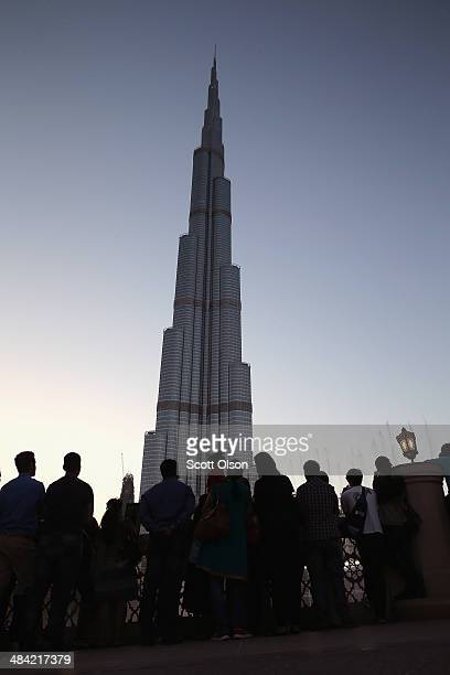 Vistors view the Burj Khalifa on April 9 2014 in Dubai United Arab Emirates At 2722 ft the building is the world's tallest manmade structure