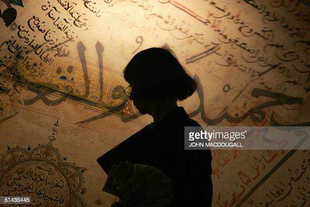 A vistors walks past reproductions of old Arabic manuscripts at the stand of the Biblioteca Alexandrina during the Frankfurt Book Fair 06 October...