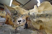 Visual artist David SartreDoublet works on fullscale reproductions of fresco paintings of the cave of PontD'Arc on June 12 2014 in a studio in...