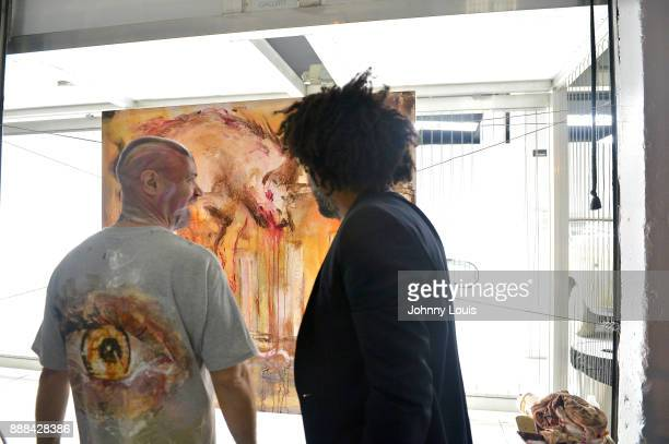 Visual artist Santiago Betancur Z and Elo attend a Private viewing and QA with Billy Corben and Mickey Munday An Exhibit of the automotive culture in...