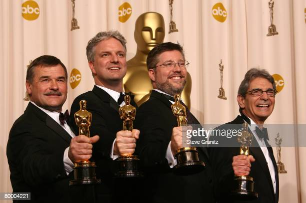 Visual effects artists Bill Westenhofer Ben Morris Trevor Wood and Michael L Fink pose in the press room during the 80th Annual Academy Awards at the...
