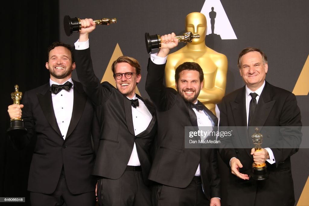 Visual effects artists Dan Lemmon, Andrew R. Jones, Adam Valdez and Robert Legato, winners of Best Visual Effects for 'The Jungle Book' pose in the press room at the 89th Annual Academy Awards at Hollywood & Highland Center on February 26, 2017 in Hollywood, California.