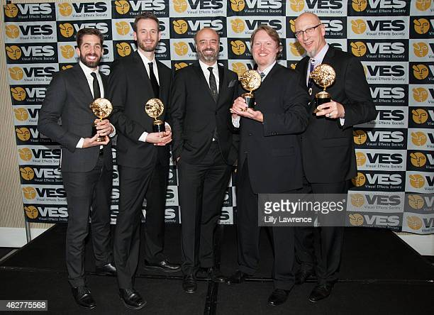 Visual Effects award winners Don Hall Chris Williams Roy Conli Zach Parrish with actor Scott Adsit attend The 13th Annual VES Awards Arrivals at The...