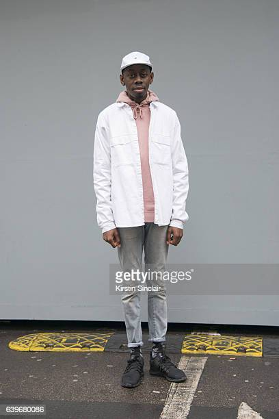 Visual Merchandiser Aaron Duncan Barry wears Adidas trainers H and M jeans Asos jacket Top man sweater and Fila hat day 2 of London Mens Fashion Week...
