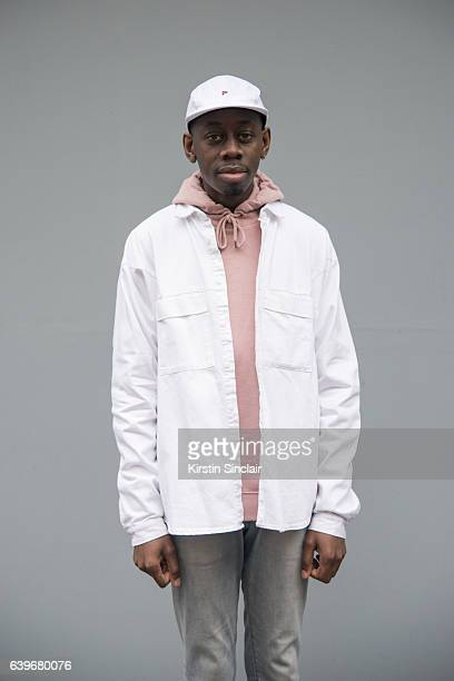 Visual Merchandiser Aaron Duncan Barry wears H and M jeans Asos jacket Top man sweater and Fila hat day 2 of London Mens Fashion Week Autumn/Winter...