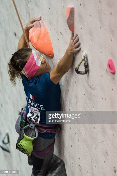 Visually impaired climber Sabine Ladel of France competes in the English stage of the IFSC Paraclimbing Cup at the Awesome Walls climbing centre in...