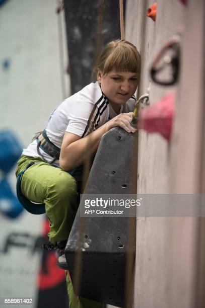 Visually impaired climber Tanja Glusic of Slovenia competes in the English stage of the IFSC Paraclimbing Cup at the Awesome Walls climbing centre in...