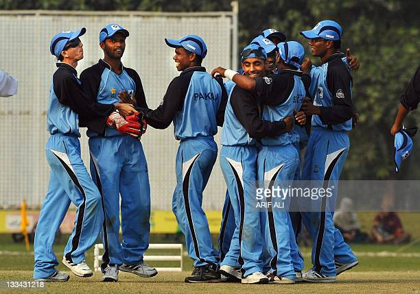 Visually impaired Indian cricketers celebrate after winning the Twenty20 cricket match between Pakistan and India blind cricket teams in Lahore on...