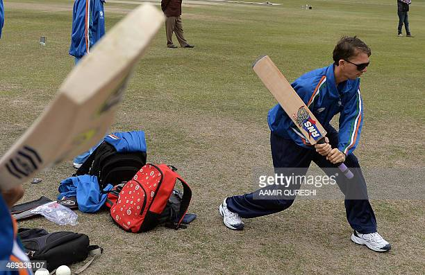 Visually impaired Indian cricketers take part in a practice session at the BagheJinnah cricket ground in Lahore on February 14 2014 Indian blind...
