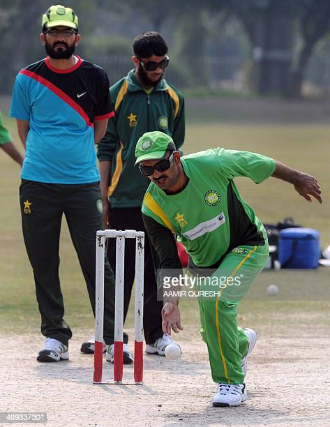 Visually impaired Pakistan cricketers take part in a practice session at the BagheJinnah cricket ground in Lahore on February 14 2014 Indian blind...