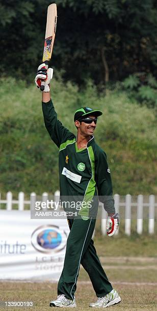 Visually impaired Pakistani cricketer Mohammad Zafar celebrates after scoring a century agains India during the first oneday international cricket...